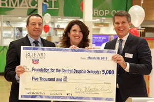 To further celebrate the grand opening of store #7894, Rite Aid Chairman and CEO John Standley, left, and President and COO Ken Martindale present a $5,000 grant from The Rite Aid Foundation to the Foundation for the Central Dauphin Schools. Pictured at center is Amy Snyder, coordinator of the foundation's PowerPack program.